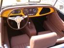 Lakovaná palubní deska a dřevěný Moto-Lita volant